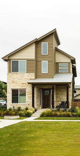 AUSTIN - CIRCA APRIL 2017: Newly constructed homes are ready for sale in a suburb of Austin, Texas.