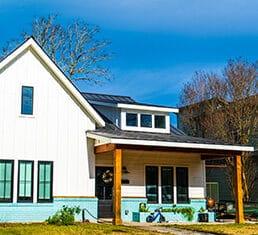 Real estate modern homes modern day living in Austin Texas suburb neighborhood large white modern home new development in central Austin