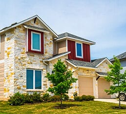 red trim around windows and nice brick homes , houses , real estate mansions and luxury living in the Suburbs of Austin , Texas , USA