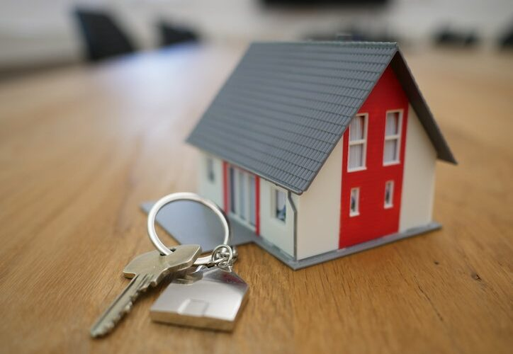 image of toy house with house keys