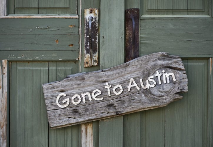 An old gone to Austin, Texas sign.
